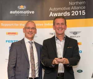 Michael Doyle DHL presents Logistics Excellence Award to Paul Darwent Chairman of Mini Gears